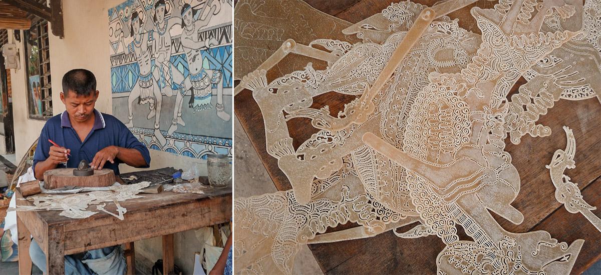 Artigiani che realizzano i wayang traforando con un punteruolo la pelle di bufalo