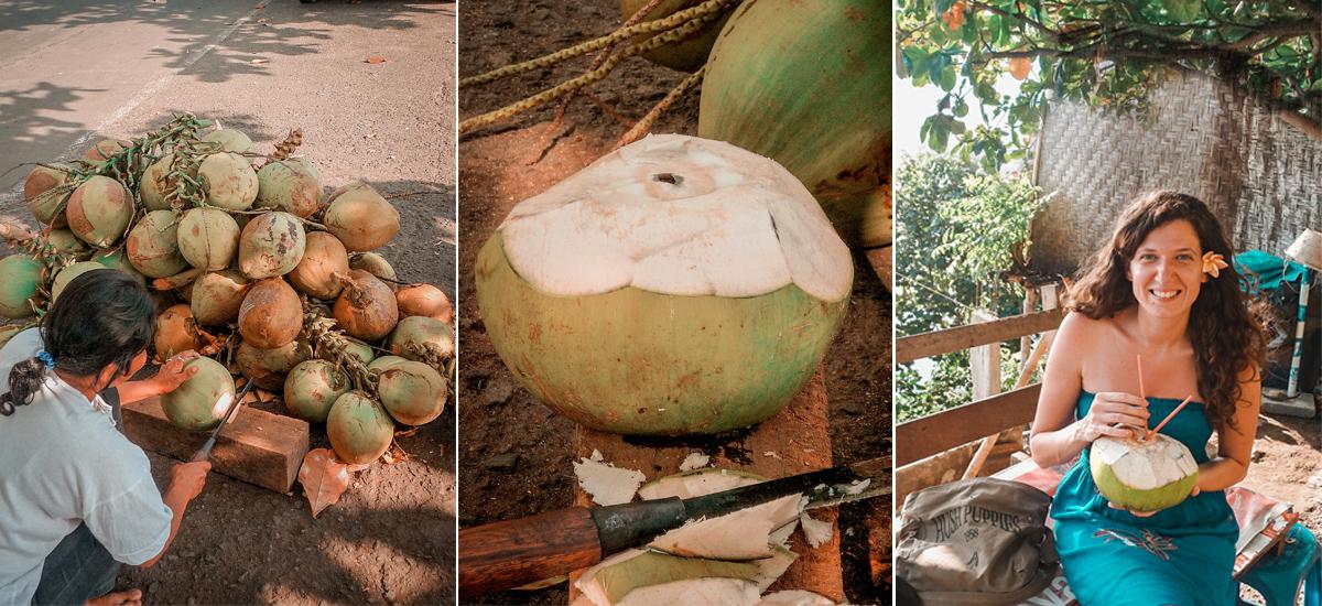 Una venditrice di cocco mentre taglia col macete il frutto